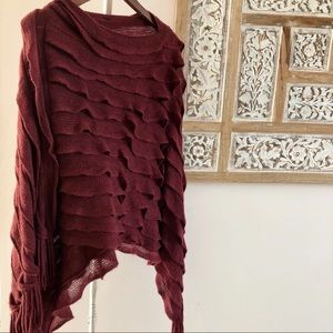 Poncho with layered frills and hanging strings